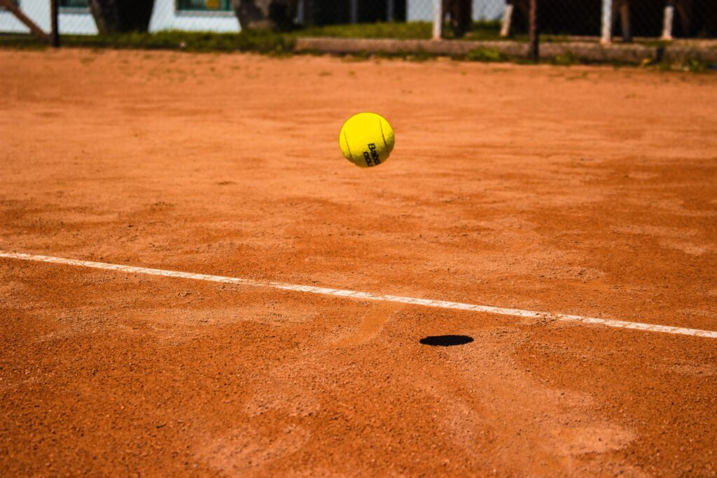 tennis ball bouncing on ground